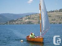 This classic 1947 wooden sailing dinghy is a head