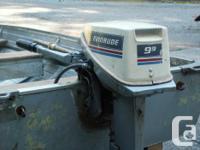 Boat with highlander trailer and 9.8 evinrude engine,