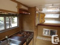 Have a 14' nose to tail truck camper for sale. Was