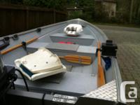 14.6 Lifetimer welded aluminum boat and trailer.