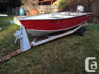 Boat has been recently cleaned, has trailer, two