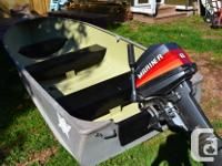 14 Ft aluminum boat with an 8 hp Mercury outboard