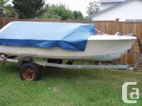 older boat on trailer with 25 hp. Yamaha, tiller arm