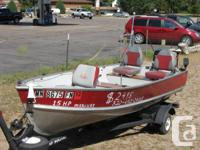 This is a - 14' Lund Light weight aluminum Angling