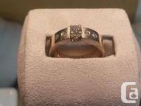 Custom designed wedding ring set.   Engagement ring: