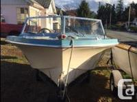 15.5 ' blue & white Hourston hull in great shape motor
