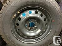 "Used 15"" 5/4.5 Steels Wheels with 215/65R15 Hankook"