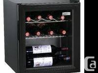 Black wine colder with glass door. Holds 15 containers