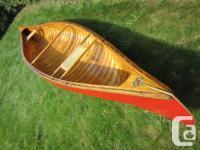 Vintage 15' Chestnut Bob's Special wood canvas canoe.