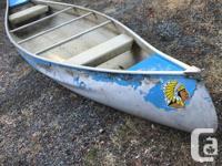 15 foot aluminum canoe has 695 pound capacity. Rare
