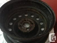 We have a set of 15 inch rims which was used on a Honda