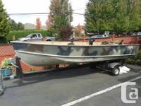 $4500 or OBO Camo in color, black U built trailer,