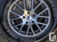 4 - 16 in silver and grey rims with 235 70R16 All
