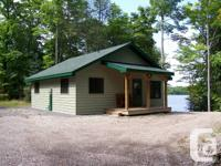 Tunnel Lake garage, shore, and cottage gazebo/pump