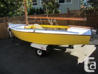 16ft Petrel design sailboat with a mainsail and 2 jibs