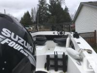 17 foot Hourston for sale $12.000 firm -90 hp Suzuki