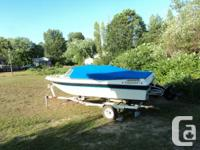 For sale or trade for smaller outboard with trailer of