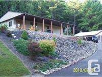 Secluded home on 34 acres wooded land. 2 -3 automobile