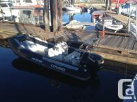 R.I.B. fiberglass hull. with '04 Evinrude ETEC 90H.P.