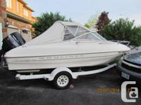 This is a 1999 18.5 feet Bayliner Cuddy with trailer.
