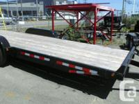 Brand new car trailer with slide-in ramps.  Comes with
