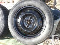 185/65/R15 winter tires on steel rims. Bolt pattern