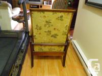 High back reclining chair with iron wheels. Has a pull