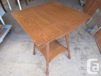 "THIS OAK PARLOR TABLE HAS A 22"" SQUARE TOP. IT IS 29"