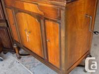THIS IS A VICTROLA GRAMOPHONE. THE CABINET IS SOLID