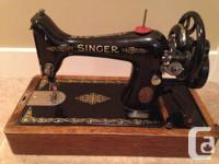1922 Singer 99 hand-crank stitching device in charming