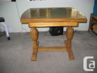 "Beautiful table with carved legs. Measures 36"" X 36"""