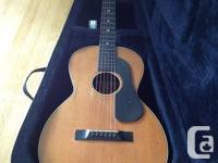 1930s Regal small body acoustic guitar with a HUGE