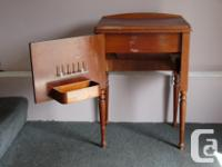 Old sewing machine in good condition. it is built into