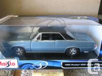 1-18 scale models of 1949 and 1950 Ford Convertibles by