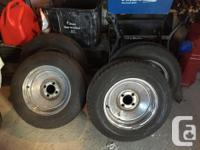 A set of four 195/70R14 Motomaster SE2 tires. These