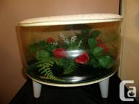 A rare find is this 1950's clear plastic foot-stool or