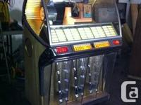 This is a gorgeous 1954 Juke box that really rocks.  It