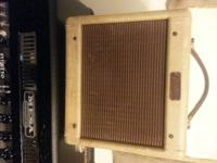 Offering a good condition 1956 Fender Champ amp.