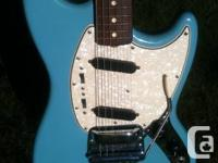 This is an all original 1965 Fender mustang in Daphne