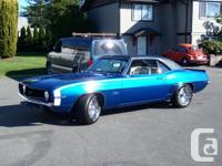 1969 Blue Chevrolet Camaro equipped with 327 V8, 4