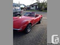 All initial. Numbers matching. red 69 corvette stingray
