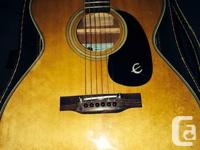 It has a light, lacquered, solid spruce top. The sides,