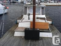 Priced for quick sale, wood hull good shape. Overall