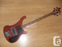 1973 Rickenbacker 4000 Bass. Translucent red, natural