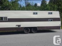 I have an older 30' travel trailer. It has three single