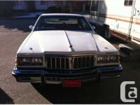 2 door automatic, 350 V8, air, tilt, cruise, cassette,