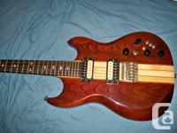 Real tone machine! Neck thru design. 2 humbuckers,