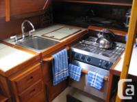 "1979 fin keel fiberglass sloop Length 34"" Draft 6'3"""