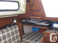 This is a well-cared-for 1981 Sunstar 28 foot sailboat.