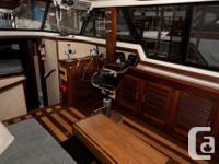 Single Diesel Sedan Motor Yacht. She has a command